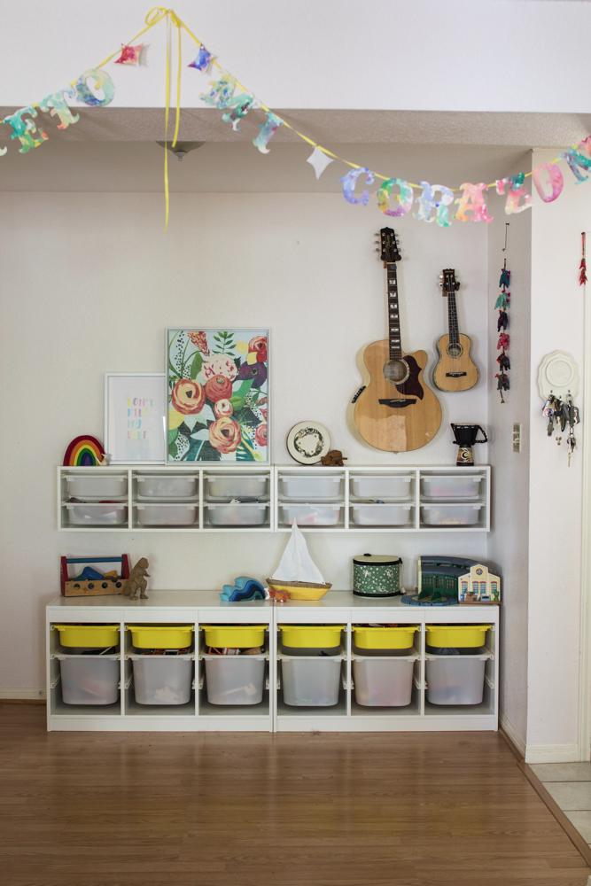A Former Dining Room Turned Storage Area Kids Bins From Ikea Art Prints And Guitars Storage Kids Room Ikea