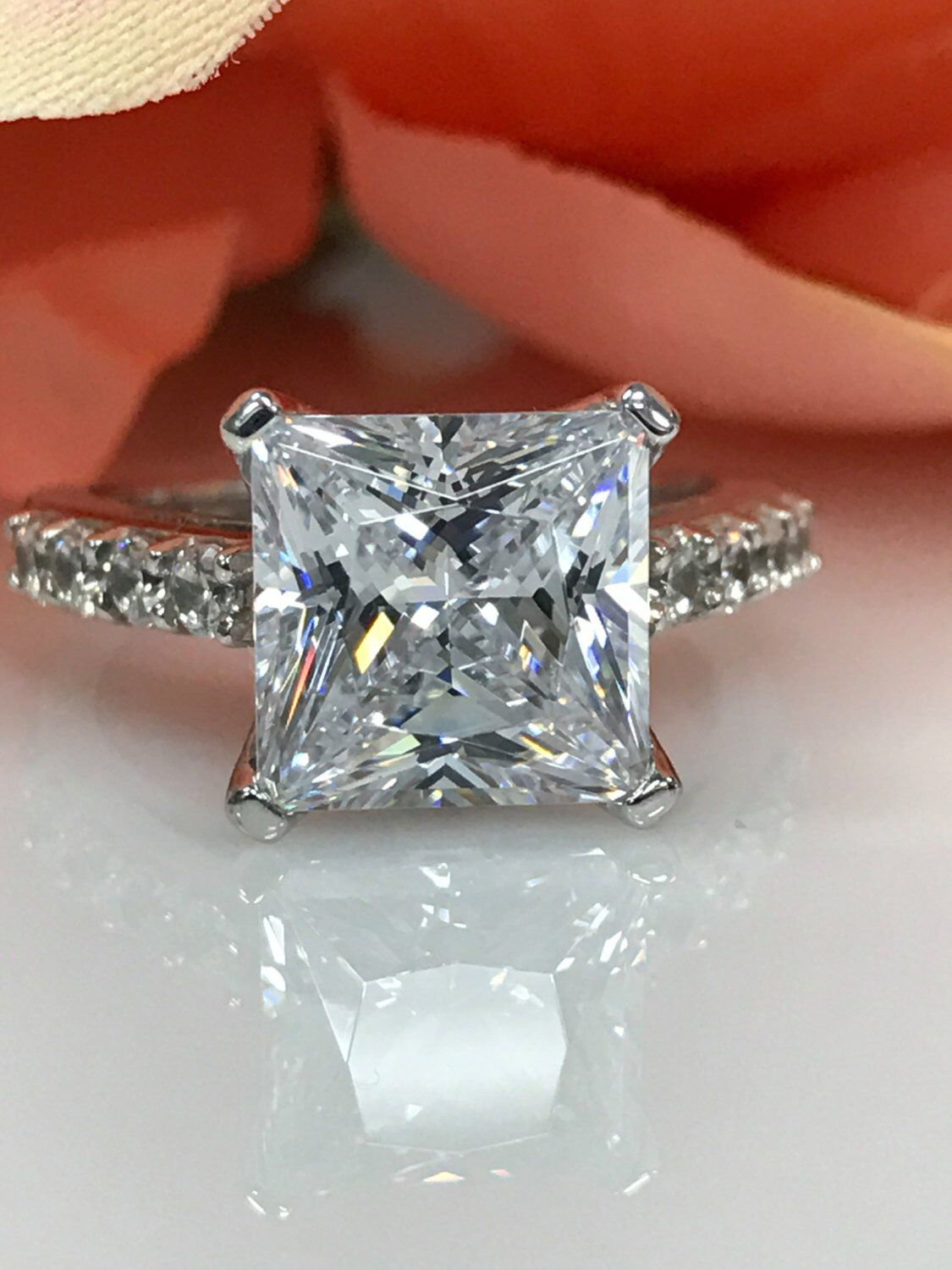 Princess cut engagement ring with round accents k white gold