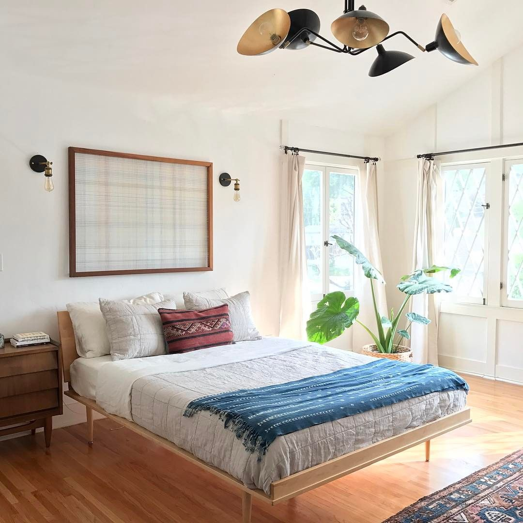 A Minimal Bohemian Bedroom With Big Windows And Bright Hardwood