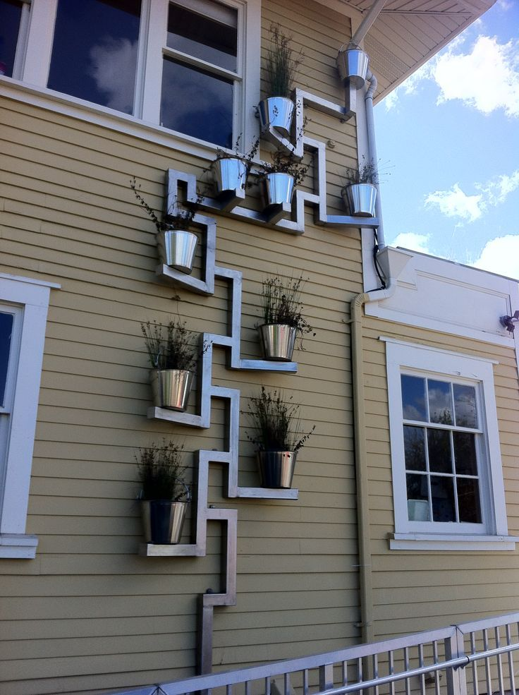 Downspout planter.  'Bucket Brigade' downspout planter sends roof water runoff…
