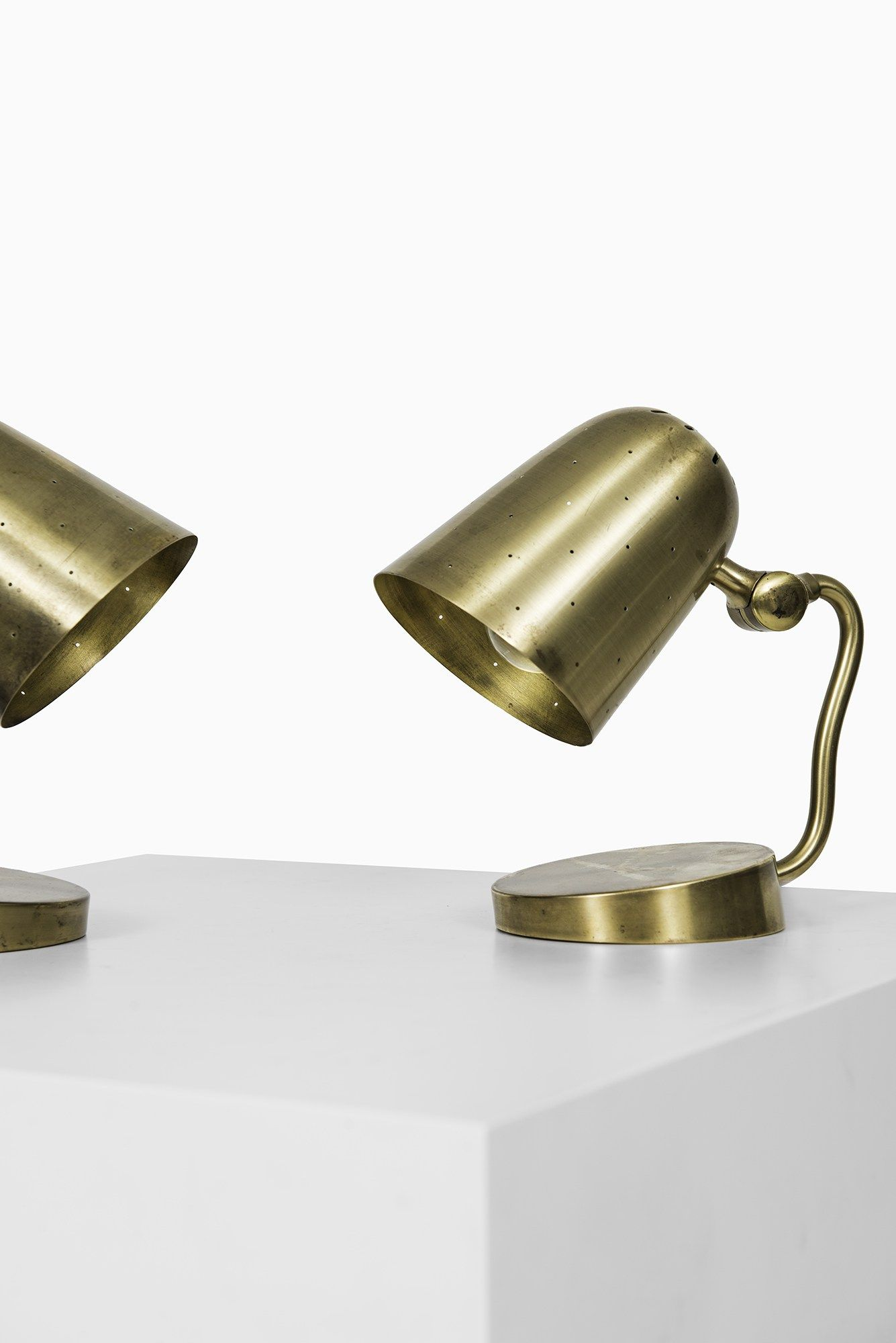 Rare pair of table / wall lamps in brass at Studio Schalling