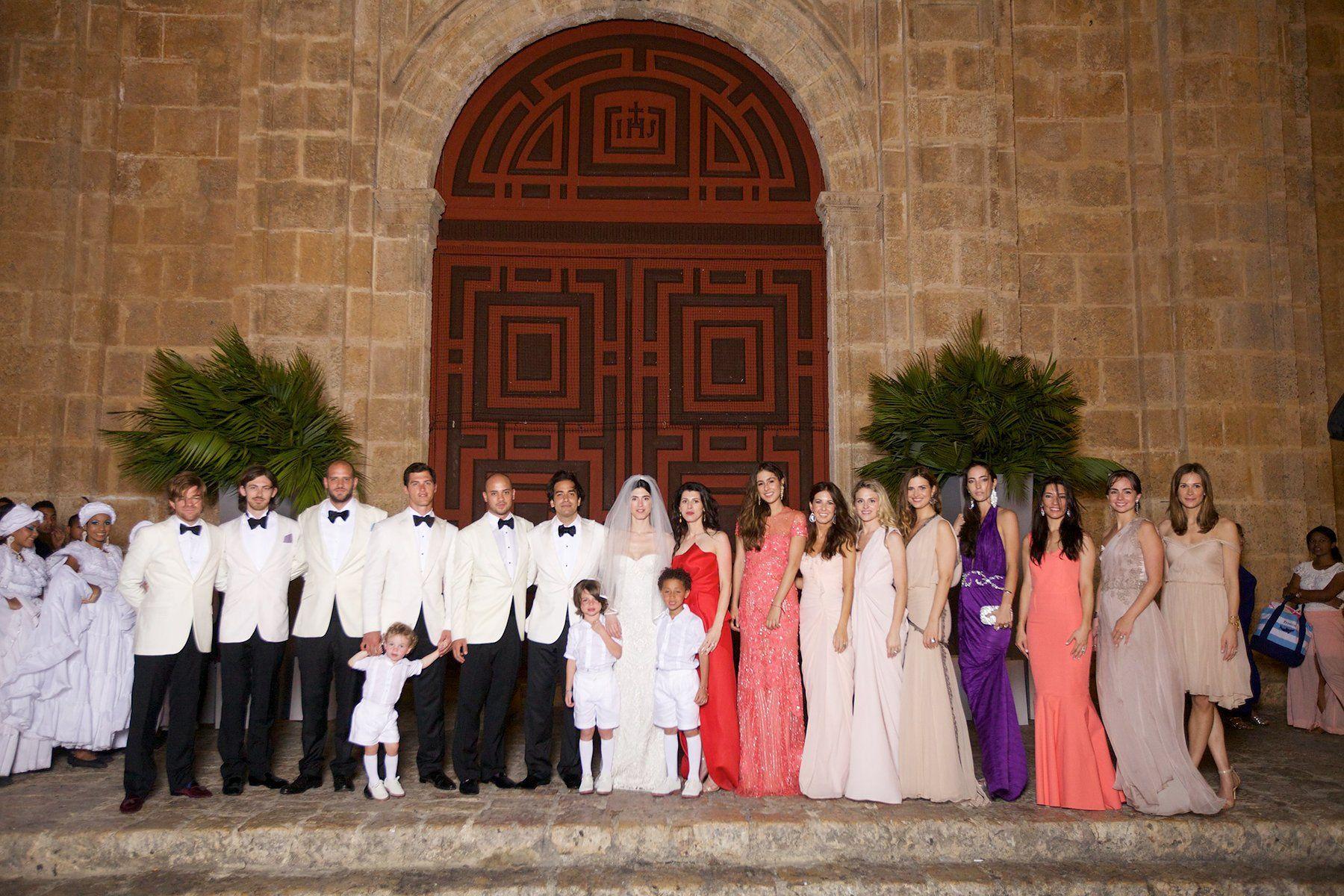 The entire wedding party in front of the church Iglesia de San Pedro Claver. I love the facade.