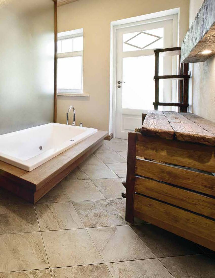 Ragno rustic tuscan bathroom evoking a modern tuscan feel evoking a modern tuscan feel this bathroom is stylish and usable the wood furniture is a perfect accompaniement to the beautiful tile flooring dailygadgetfo Gallery