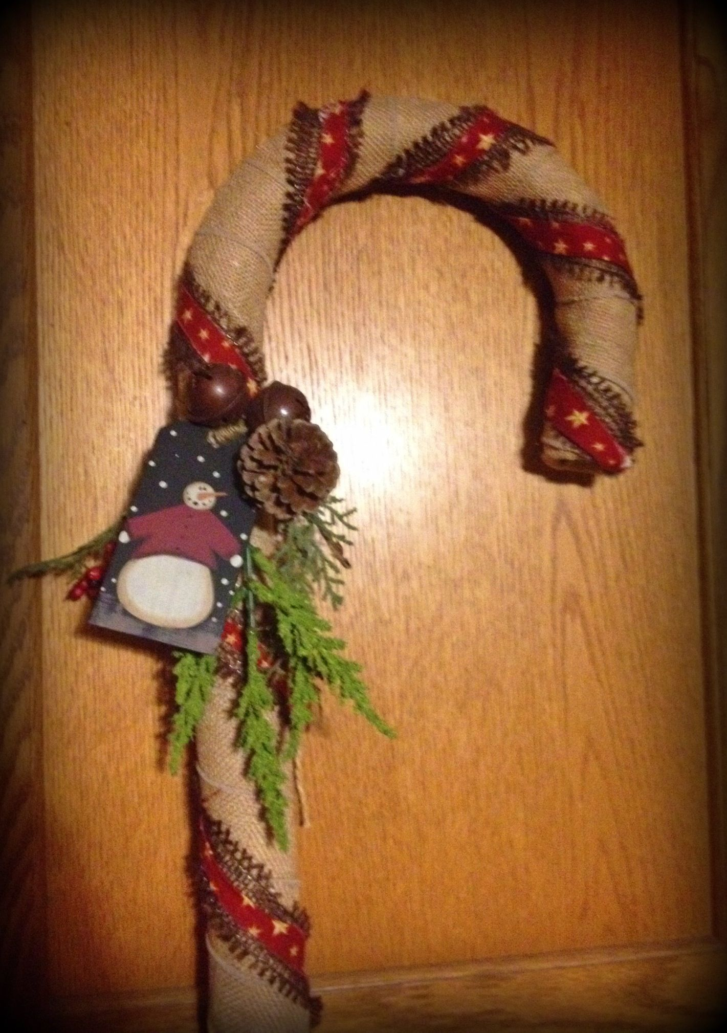 Large wrapped primitive candy cane by ye