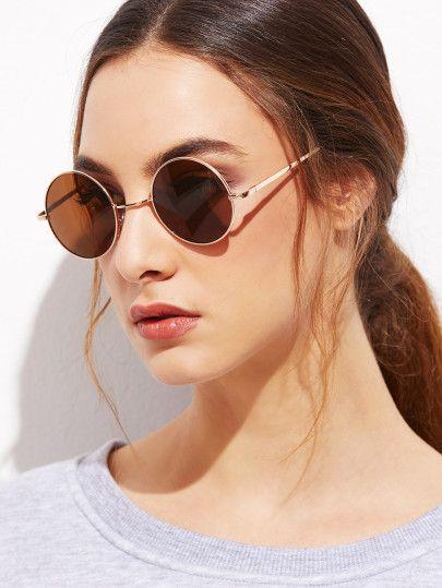 Gafas de sol con marco dorado y lentes redondo marrón  6d212f46d230