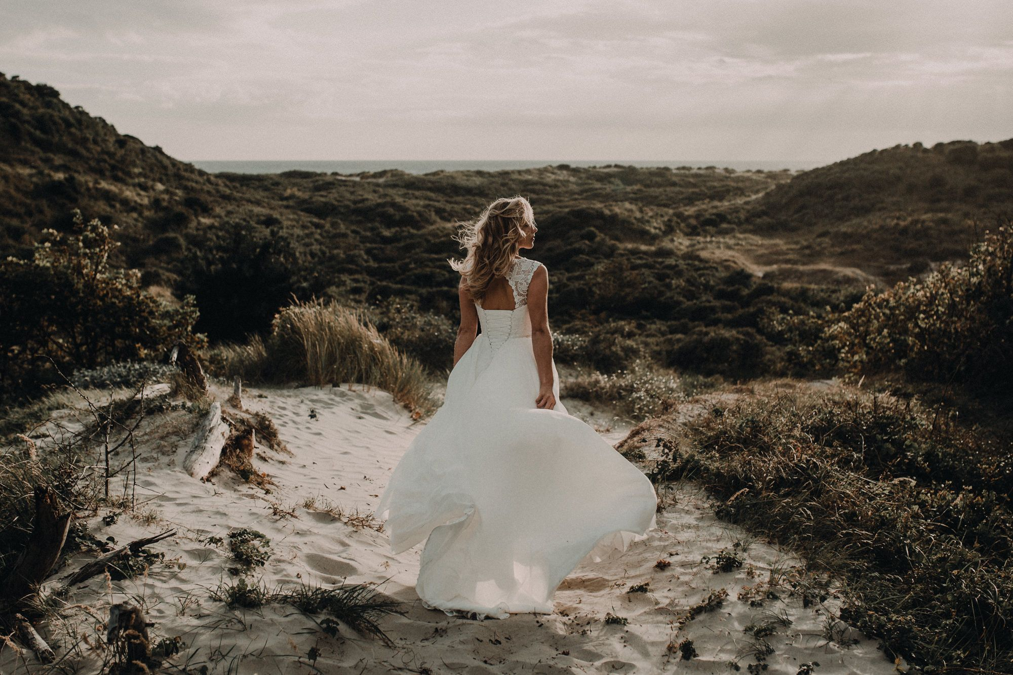Dreamy chiffon wedding gown with bold lace top and lace up back with