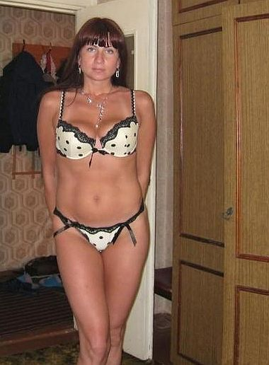 Mature woman wearing bra and panties