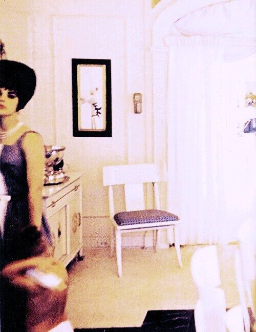 Priscilla Presley in the dining room at Graceland after her graduation, May 29, 1963.
