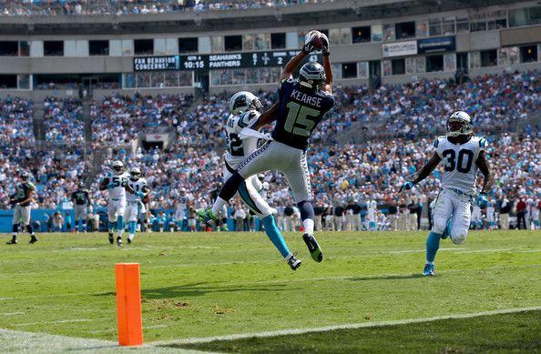 Jermaine Kearse (Seattle Seahawks) scores against Charles Godfrey and Josh Thomas (Carolina Panthers)