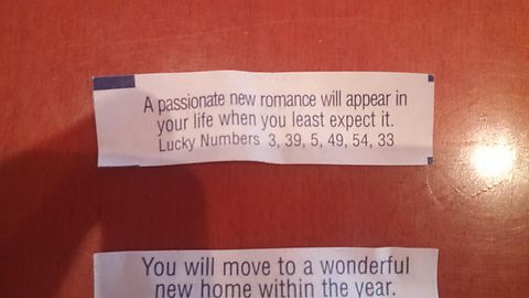 My wife's and my fortune cookies. Hers is on top.