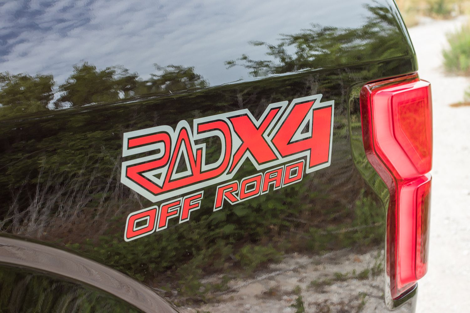 rad rides custom decal on a lifted 2018 ford f150 (With