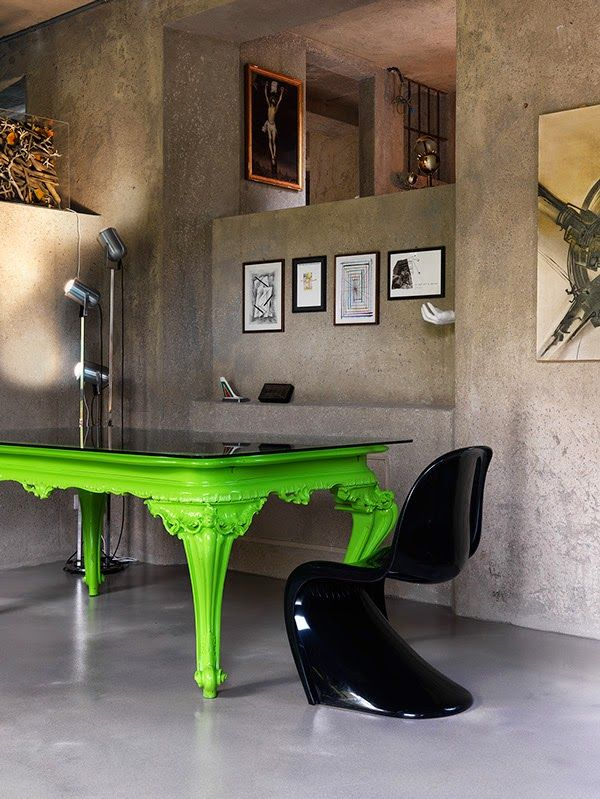 Concrete wall lime green table
