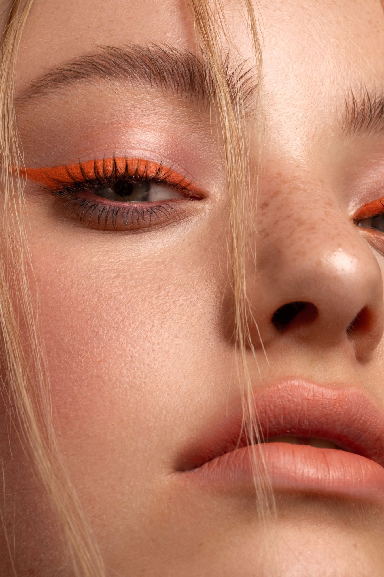 Fashion & Beauty Photography by Kayleigh June. Makeup by Stella Tu. Model is Siobhan Cotton. #freckles #orange #makeup #wing #neon #photography #beauty