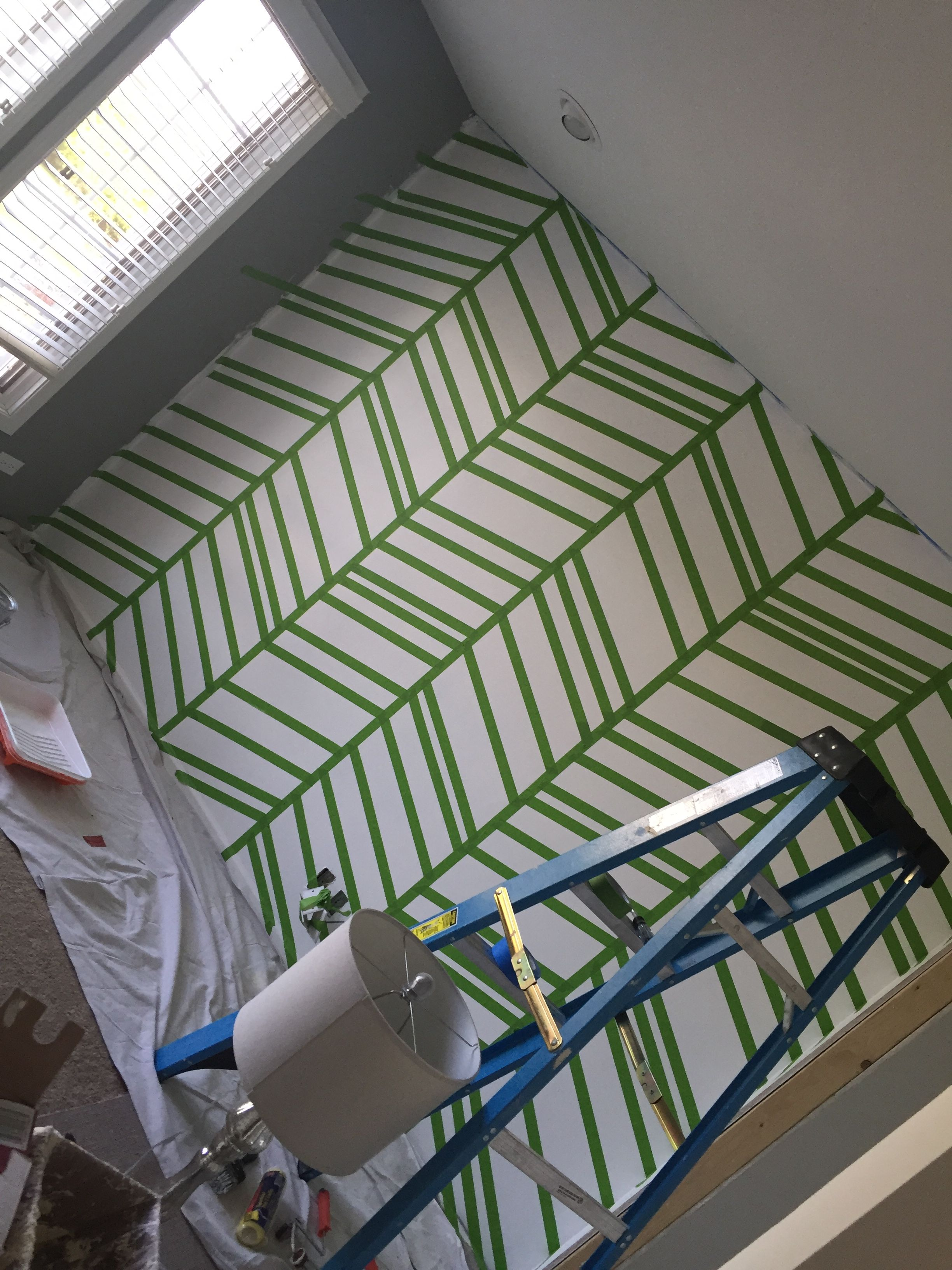 Diy tutorial of how to paint perfect stripes on a wall