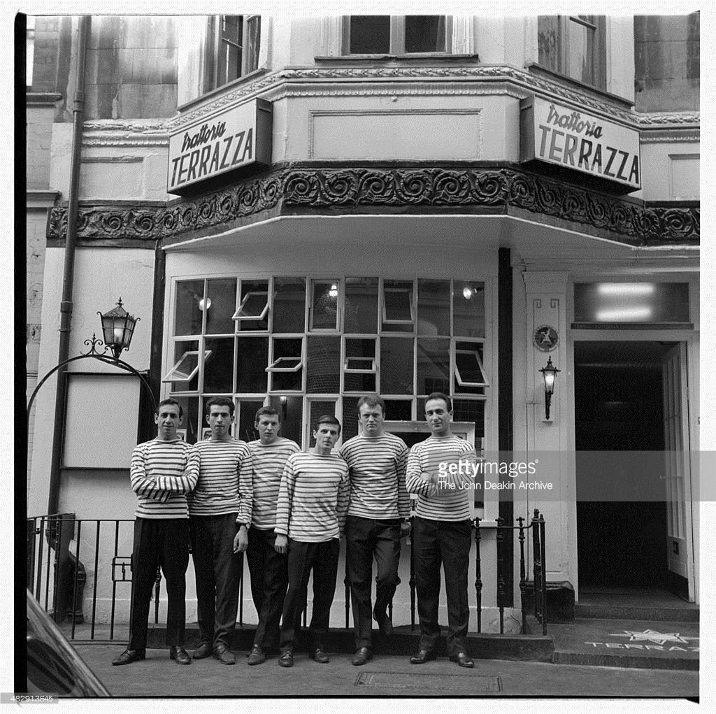 Waiters pose for the photographer John Deakin outside the Trattoria ...