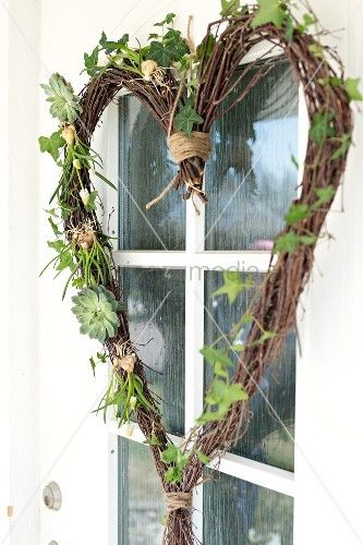 Photo of Homemade heart-shaped wreath, made of birch branches and ivy