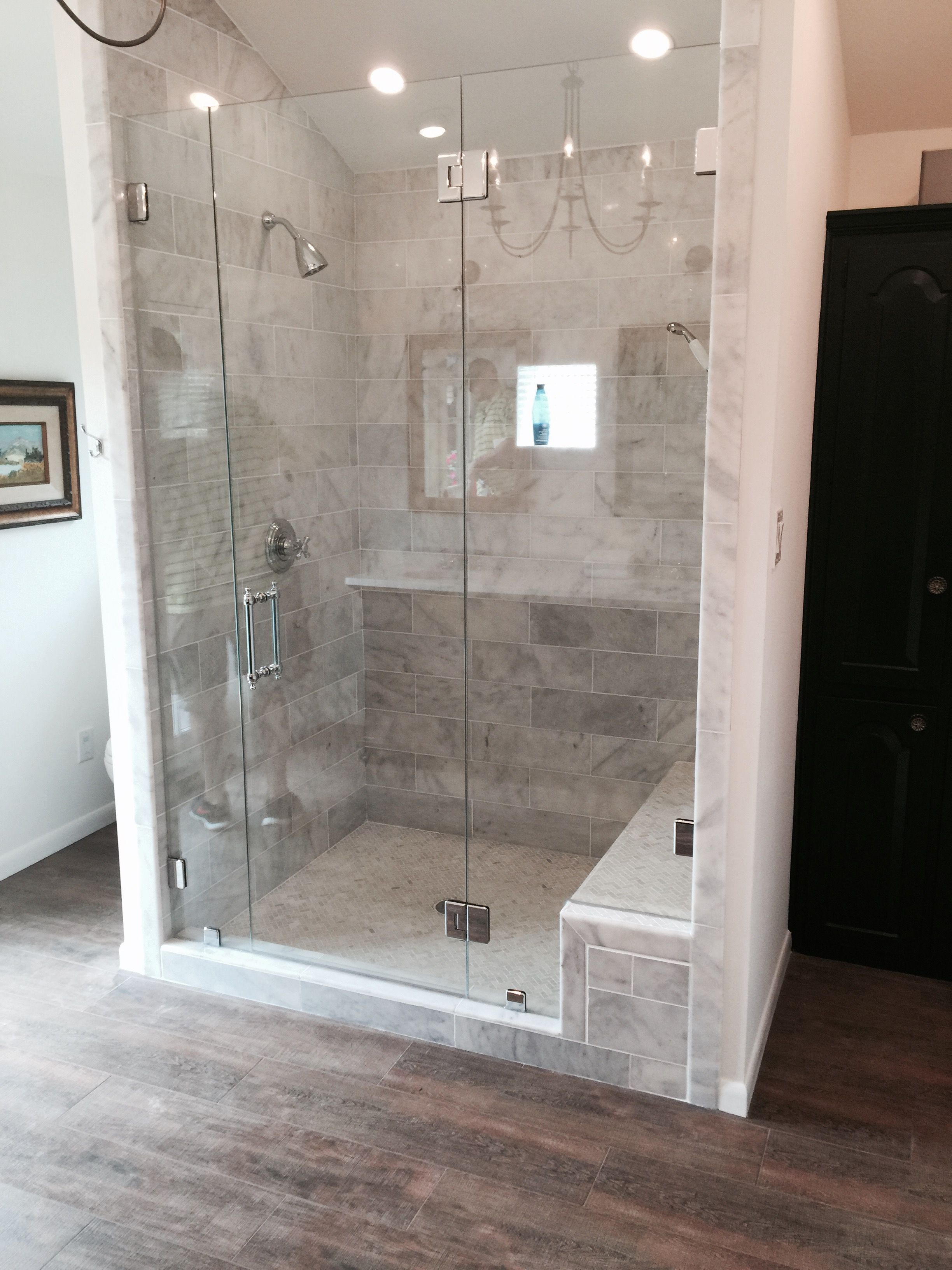 Frameless shower with a door, fixed panel, fixed notched panel ...