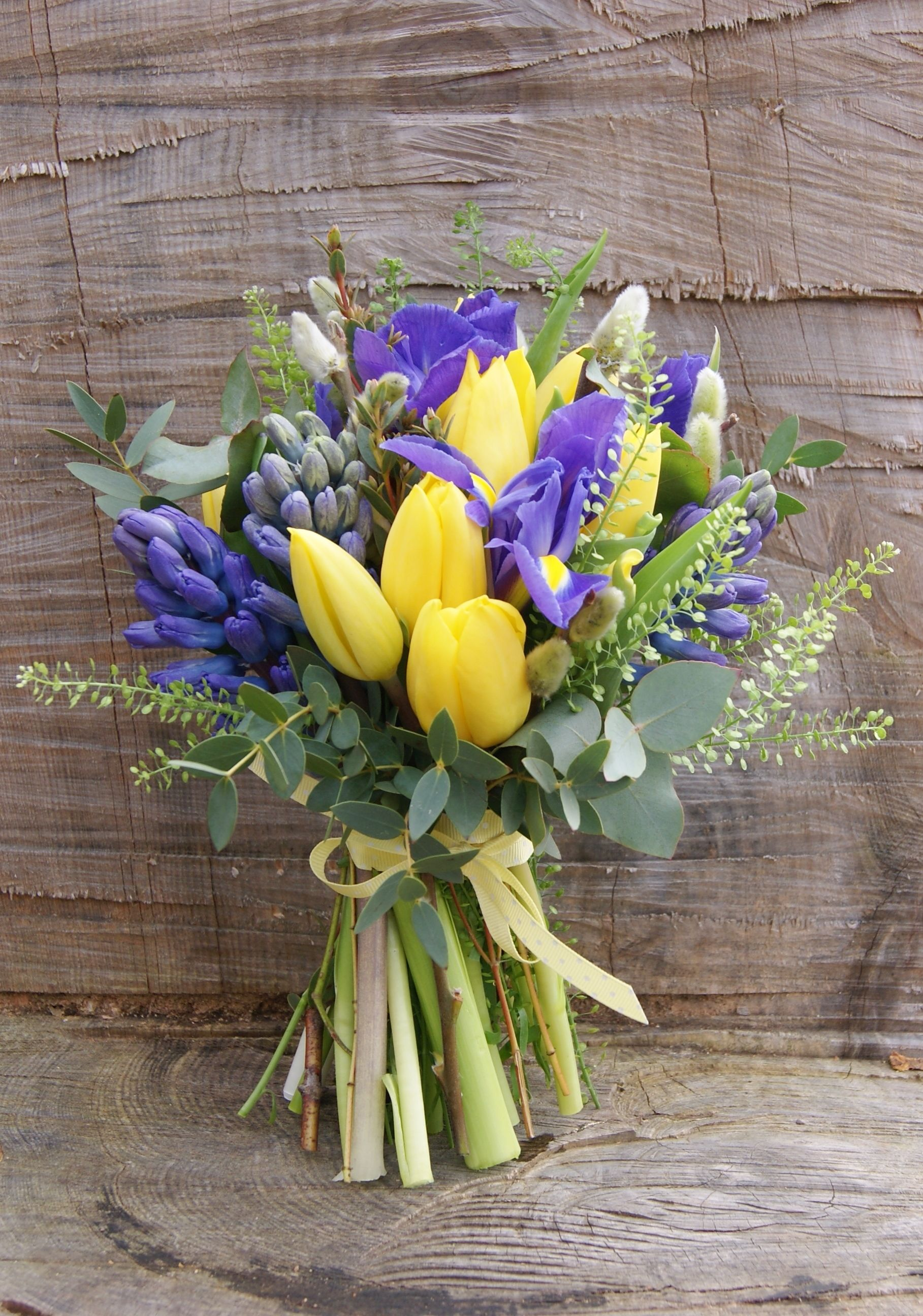 Spring Hand Tied Bridal Bouquet Of Yellow Tulips Purple Iris Green Thlaspi Blue Hyacinth And
