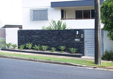 Stacked Stone Render And Aluminium Slatted Gate Fence