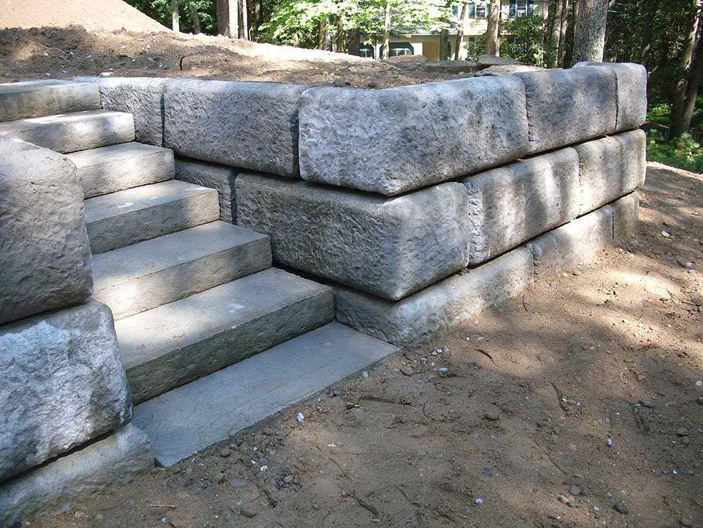 Manufactured Concrete Block Retaining Walls Are Becoming Popular As A Way To Crea Cinder Block Garden Wall Backyard Retaining Walls Landscaping Retaining Walls