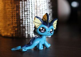 Lps custom vaporeon made from a destiny cat and on so much clay and removal of the original tail (I think...)