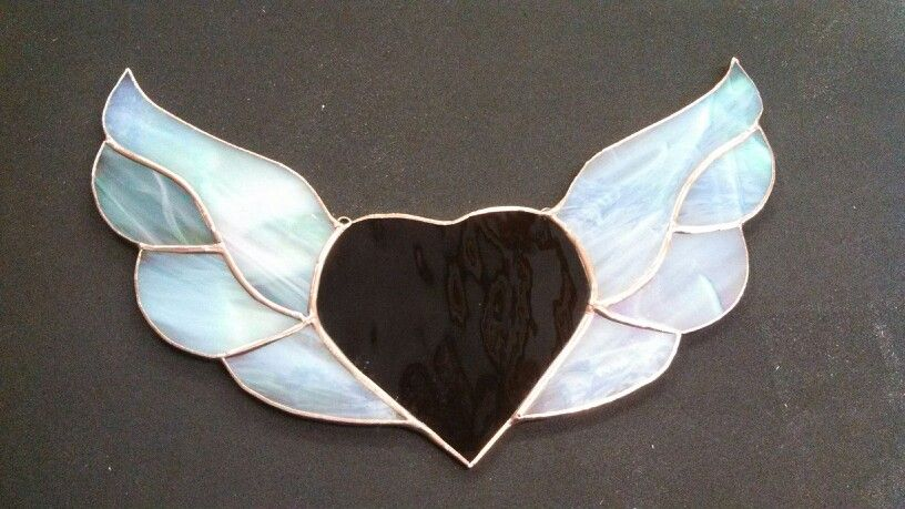 Heart is deep purple water glass wings are a white wispy irridised- it is late so will have to wait for next weekend when I am home in daylight to get one with sunlight on it.