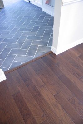 Herringbone Tile And Wood Transition Also The Colors I Was Looking To Go Living Room Tiles Herringbone Tile Floors Kitchen Floor Tile