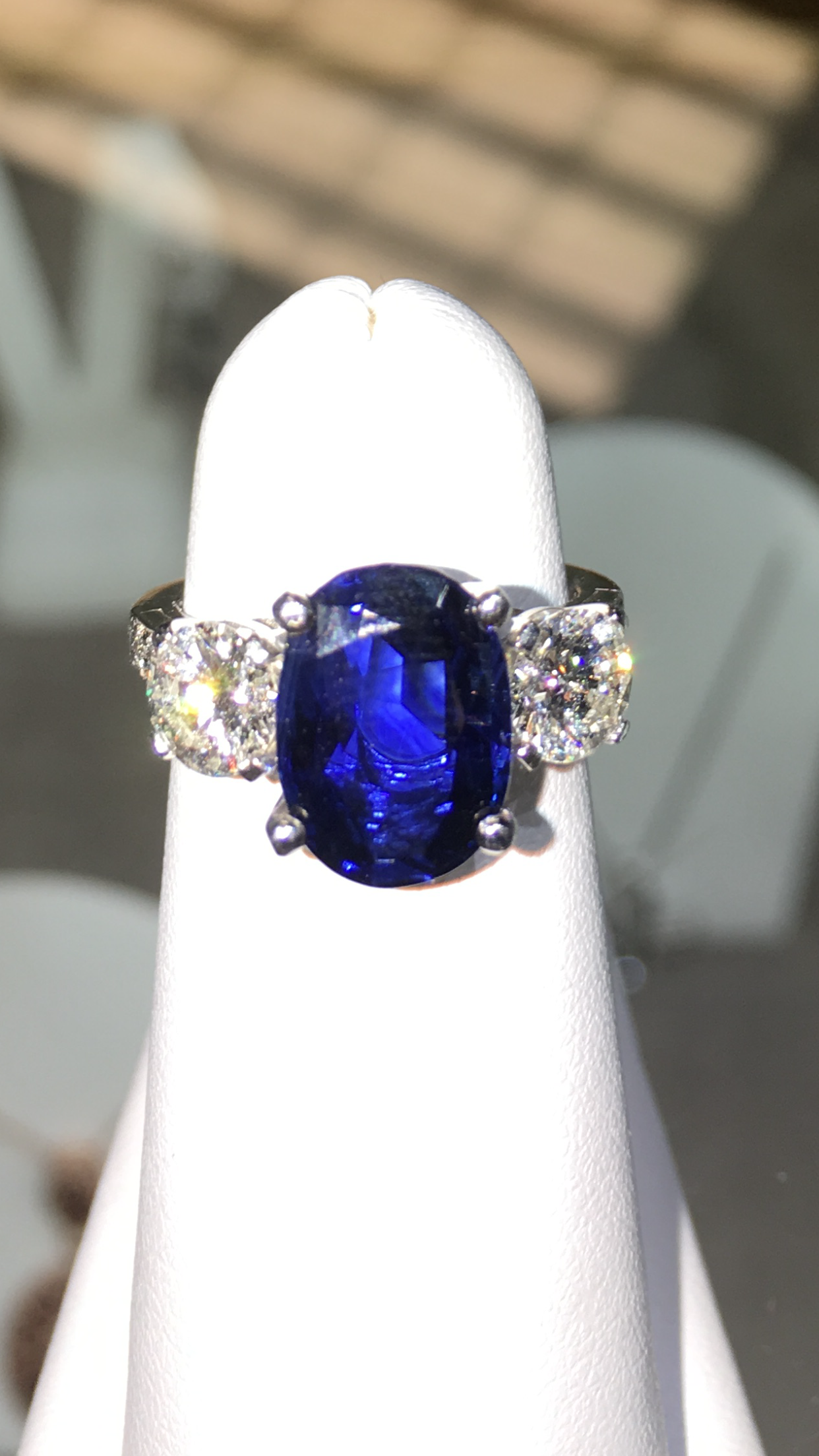 8b6dfb3021681 Tiffany 4 carat sapphire ring set on platinum flanked by two half ...