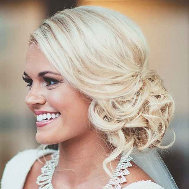 Low Bridal Updo With Soft Curls We This Moncheribridals Side Bun Hairstylesgatsby