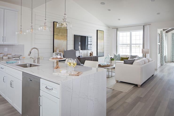 White marble like kitchen peninsula features a white quartzite ...