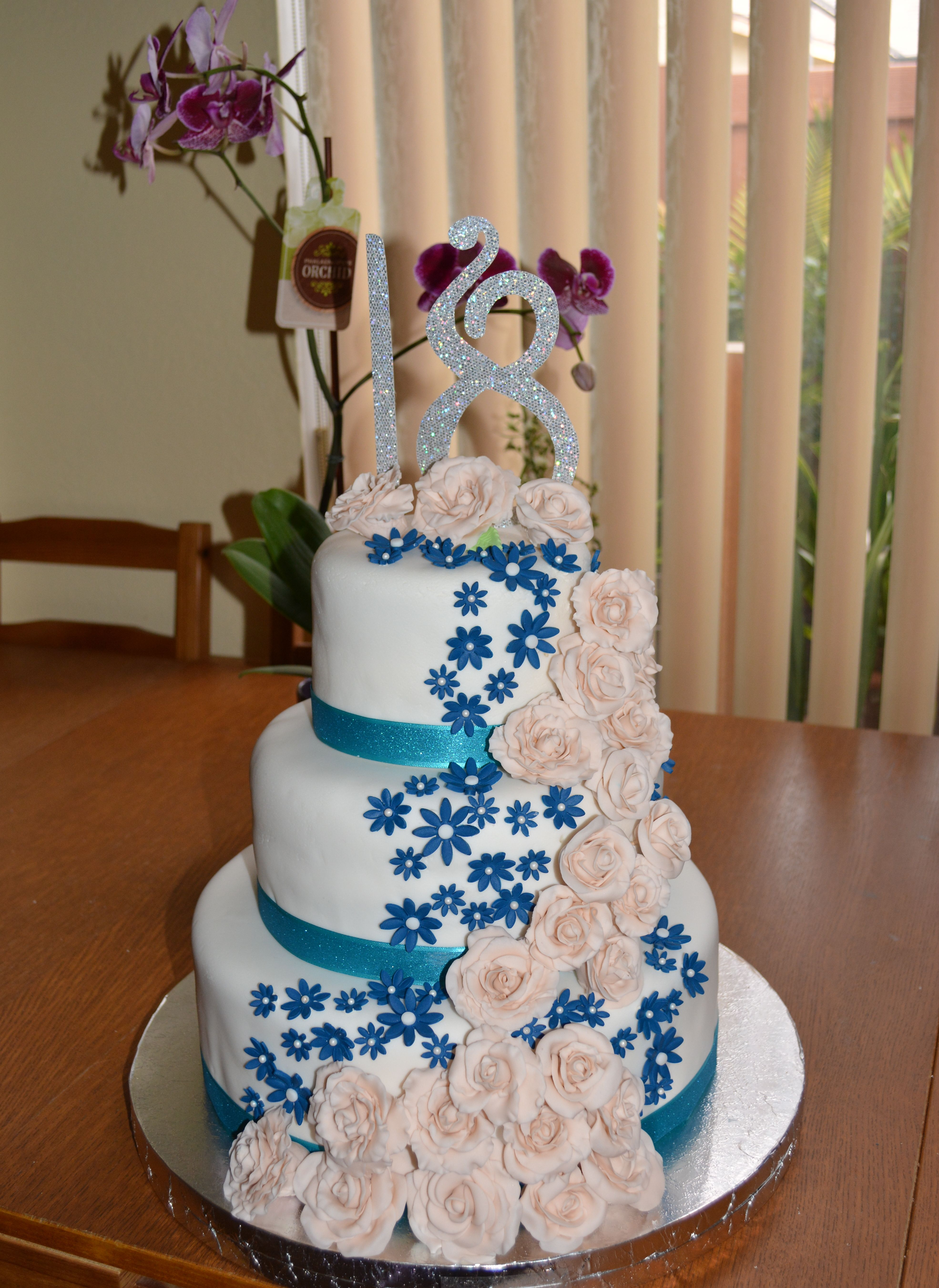 3 Tier Cake With Cascading Flowers For An 18th Debut