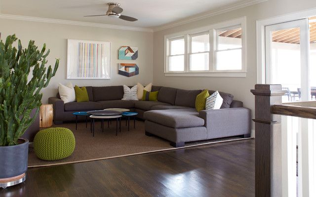 Incredible Home Family Room Interior Designed With Dark Grey Modern Sectional Sofas Completed Green Stools