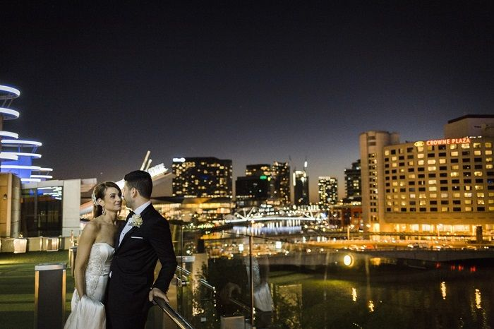 Bride and groom photo shoot with a city view for A Big Fat Greek Winter Wedding | I take you
