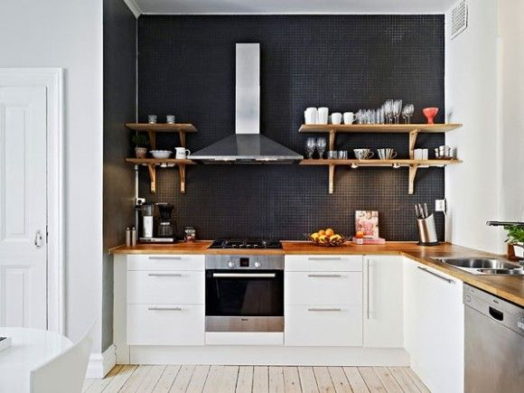 Black wall, no backsplash, open timber shelves against rangehood