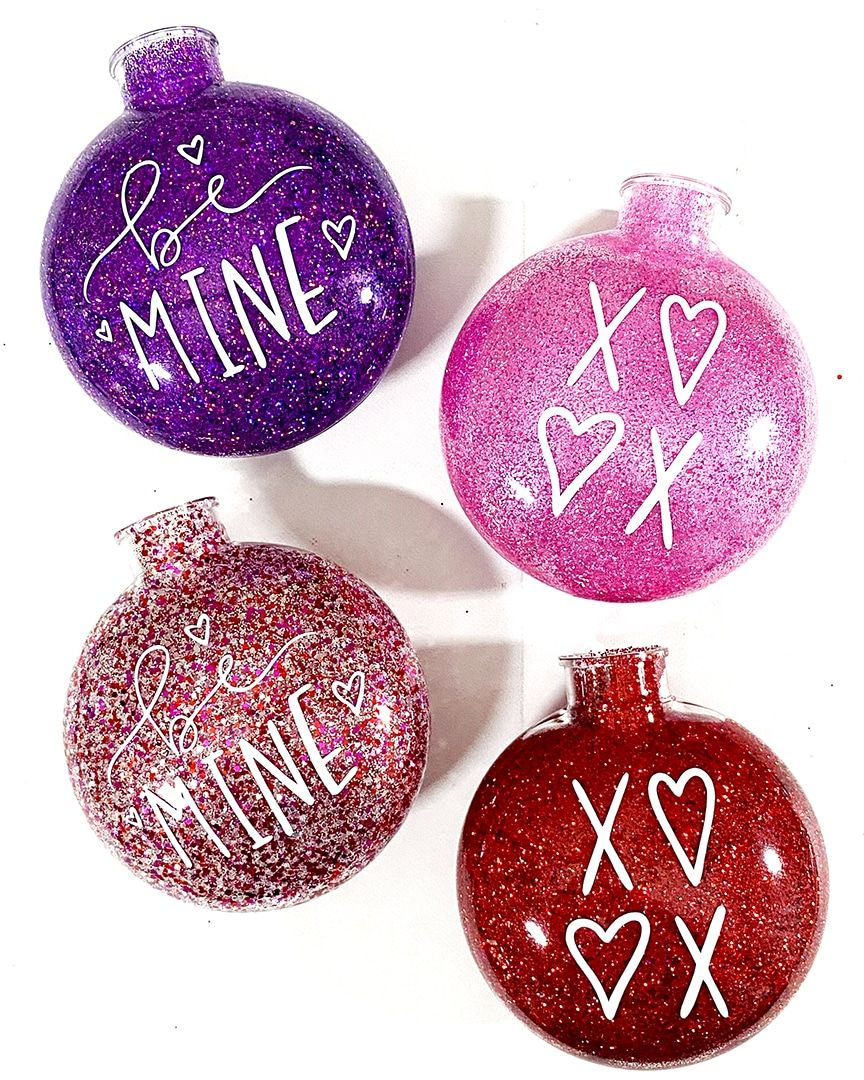 How to Make EASY DIY Glitter Valentine Ornaments - with a FREE Valentine SVG. Quick and simple tutorial by Pineapple Paper Co. #diyornaments #glitterornaments #glittercrafts #craftlightning #valentinecrafts #valentinetree #valentineornaments #easyornaments #diyvalentinesday #glitter