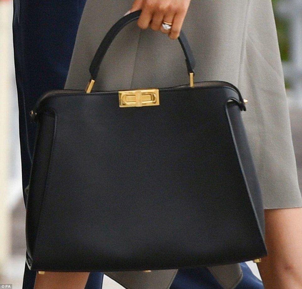 d802dd0212 Meghan's Fendi Peekaboo Essential bag (US$5,400). ID by @PerthsFashion.  Meghan's roomy black leather tote bag is by designer Fendi and costs an  eye-watering ...