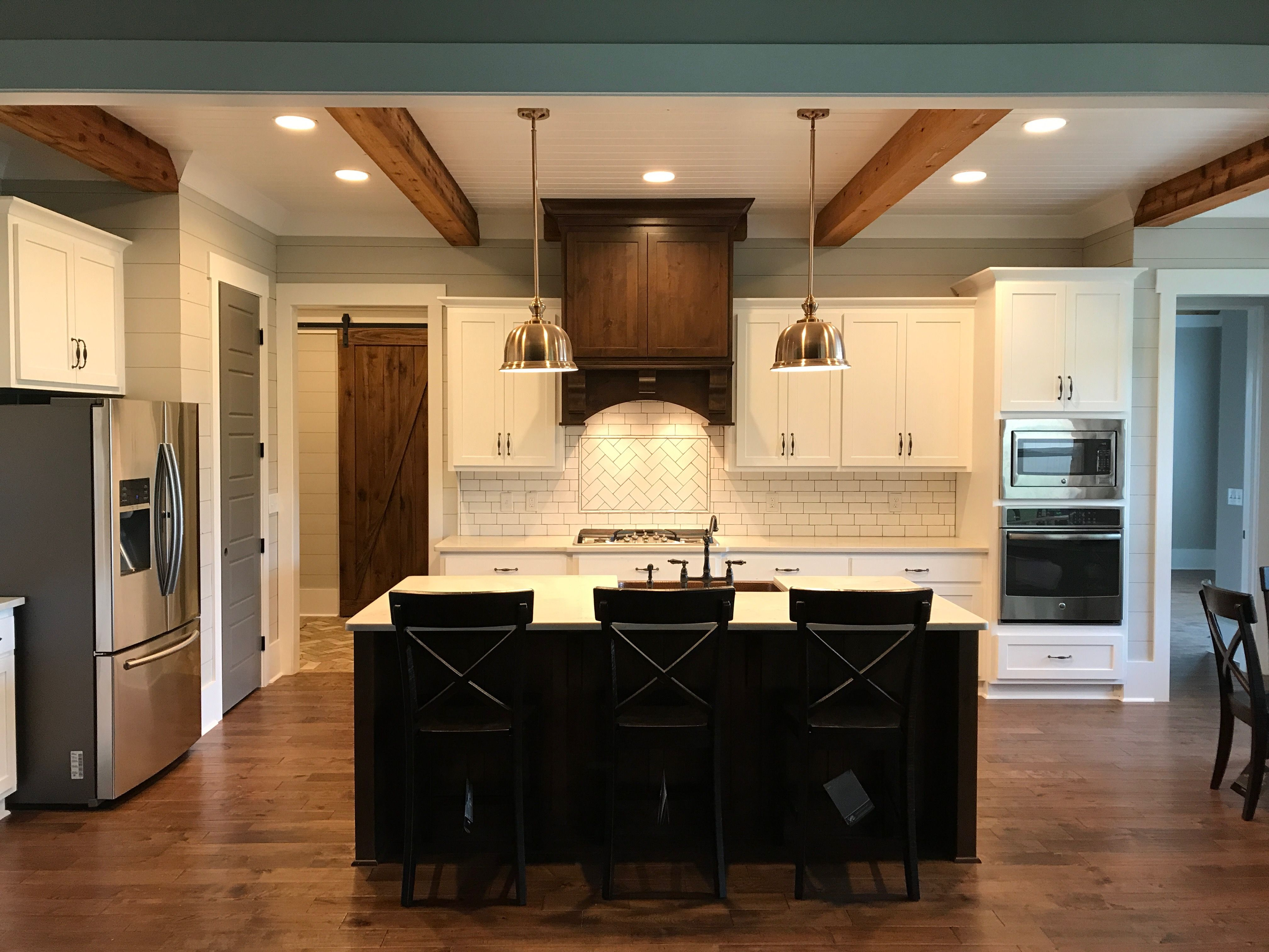 Our Kitchen White Shaker Cabinets With Stained Hood And Island Quartz Countertops Under Copper Pendants Pai Kitchen Design Birch Cabinets Staining Cabinets