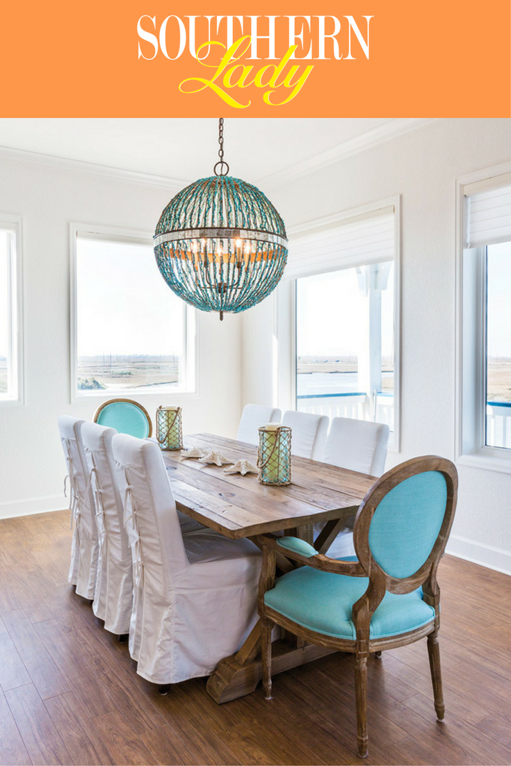 Classic dining chairs upholstered in an unexpected vivid beach blue
