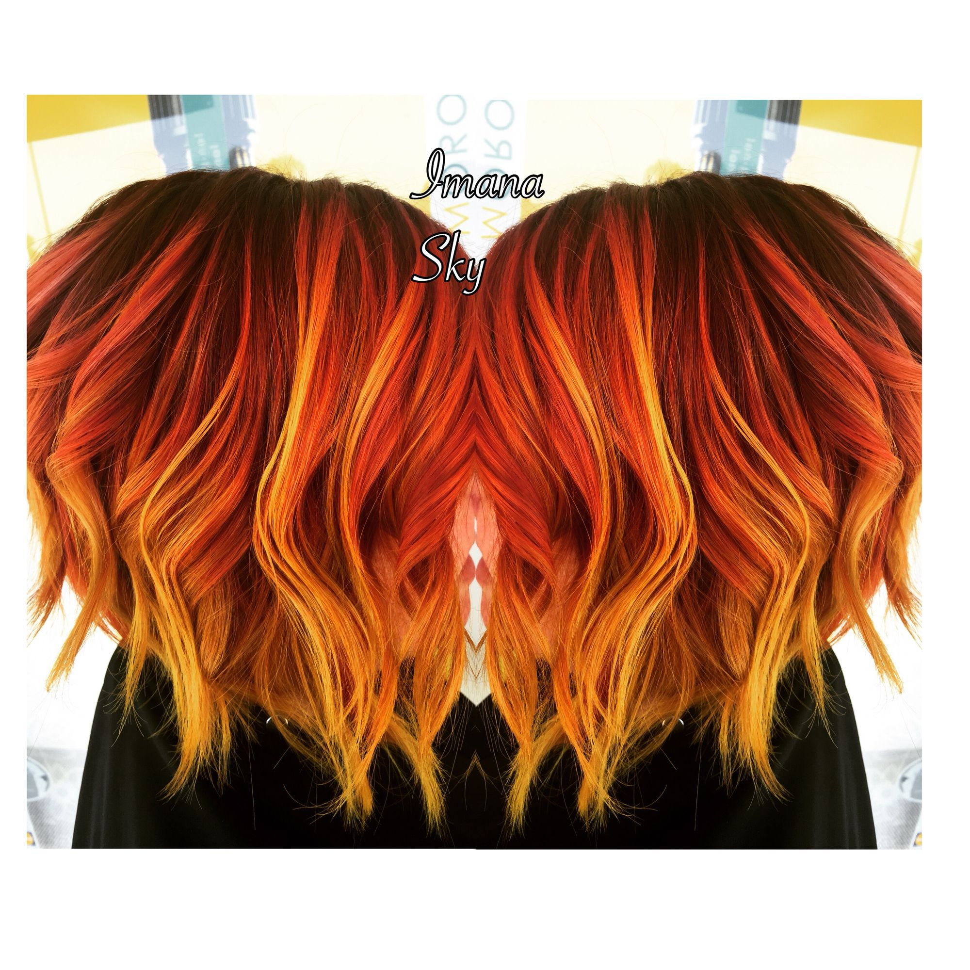 Purple roots to red orange and neon yellow flame sunset balayage
