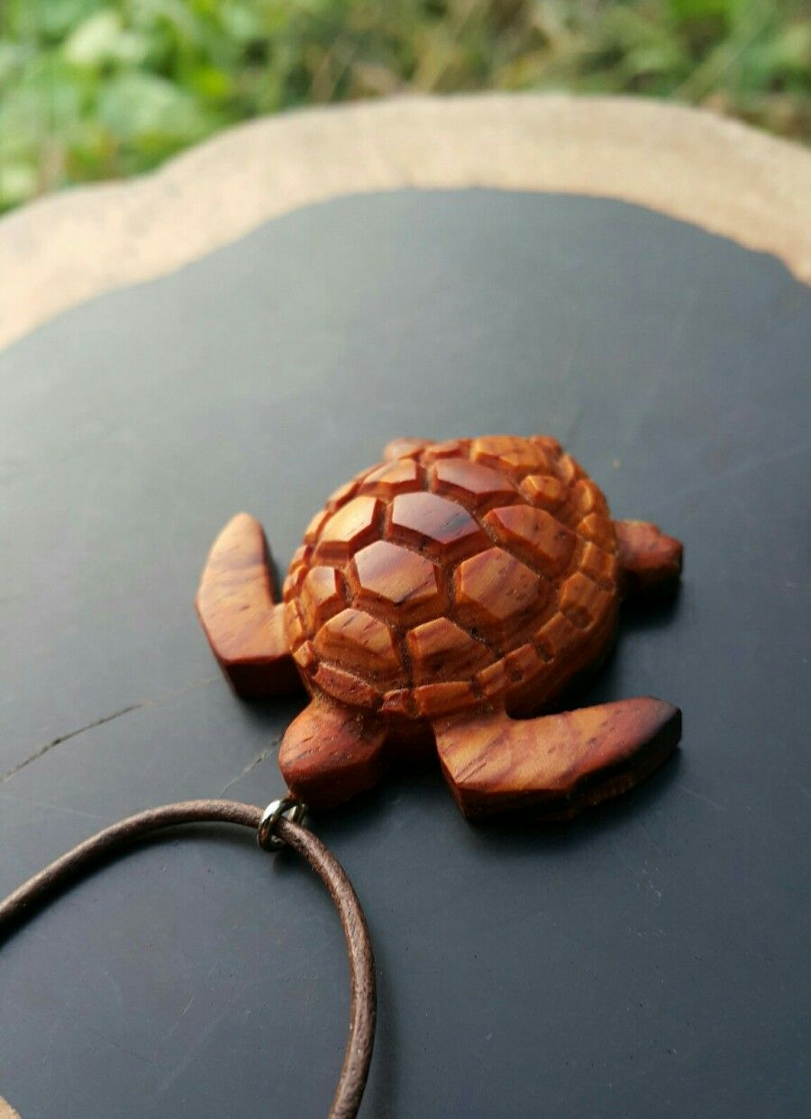 A Turtle Made Of Wood With Cocobolo Wooden Necklace Wooden