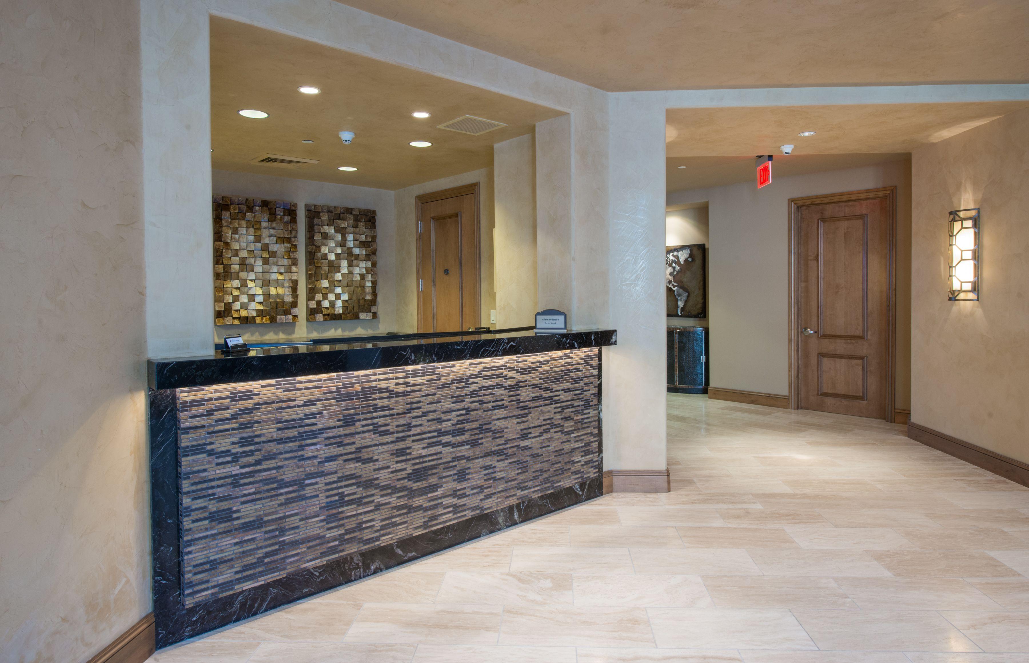 Stone Turning Marble Floor Lobby : The lobby hallway of this high end condominium residence
