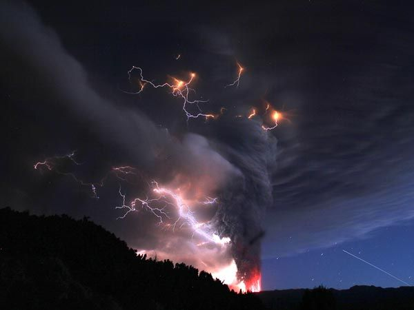Lightning crackles around a volcanic plume over a mile high rising from the Puyehue Volcano, Chile