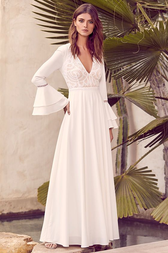 e1f1c8c50a3 ... White Lace Maxi Dress! Lovely crocheted lace overlays a nude bodice and  plunging V-neckline