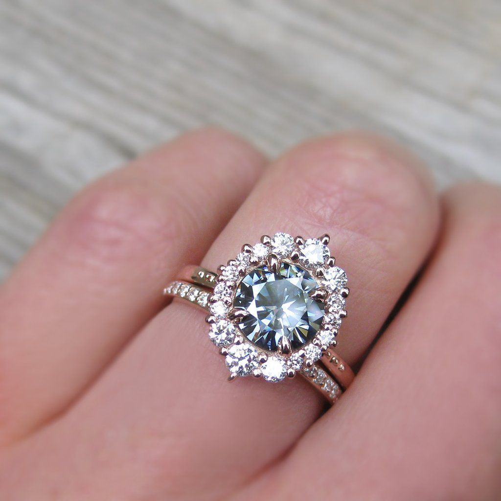 1.5ct grey moissanite halo engagement ring paired with a conflict ...