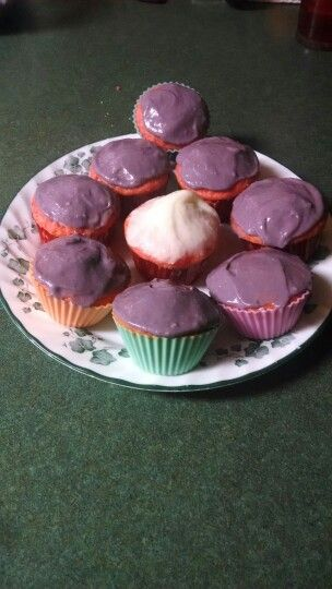 Strawberry cupcakes with purple icing with mom:)