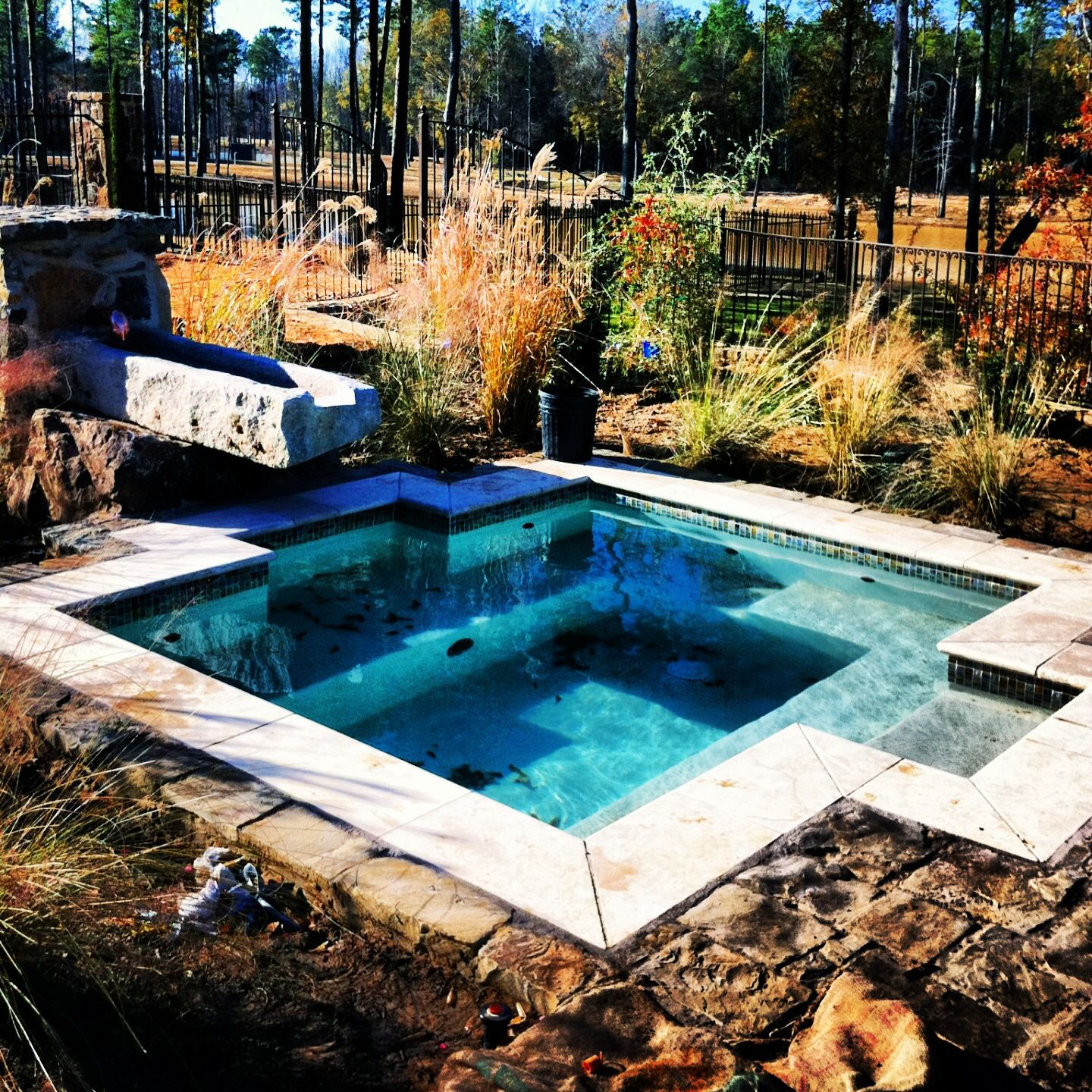 Custom gunite spa hot tub with waterfall scupper water feature, designed  and constructed by Preferred