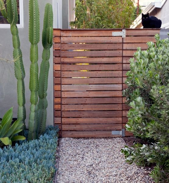 Idea for hiding recycling bins slat wood fence gate for Wood pallet fence plans
