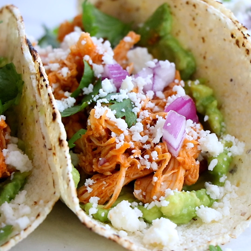 Chicken Tinga Tacos are THE BEST! Saucy, spicy, real food perfection. Includes directions for the Instant Pot. |