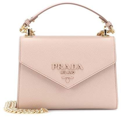 70cda68666 $1,990 Part of Prada's Monochrome series, this leather shoulder bag exudes  understated sophistication in its versatile tone-on-tone pink #bags # handbags ...