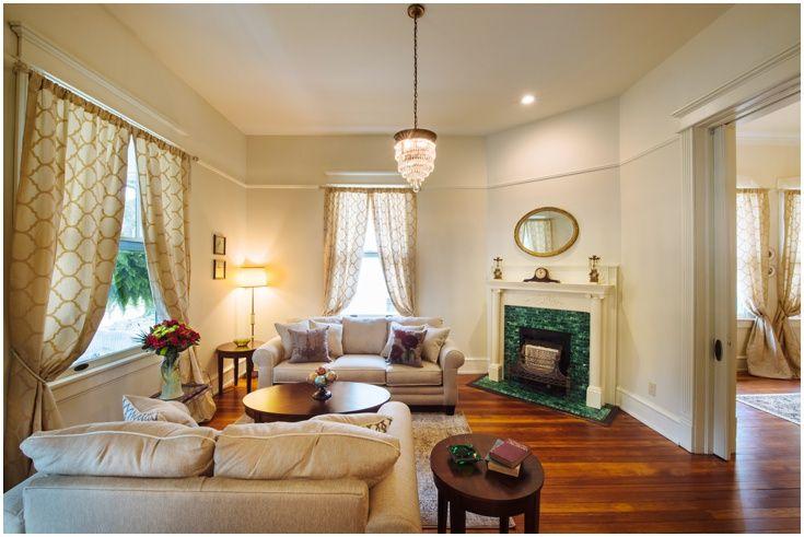 1906 Arts & Crafts Southern Home Restoration - Living Room with original chandelier and Victorian fireplace. #HomeReno #InteriorDesign #Decorating #Antique #Vintage